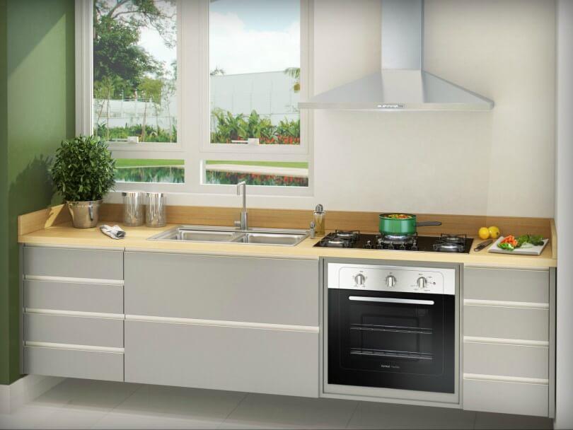 Cozinha em tons sóbrios com forno elétrico de embutir